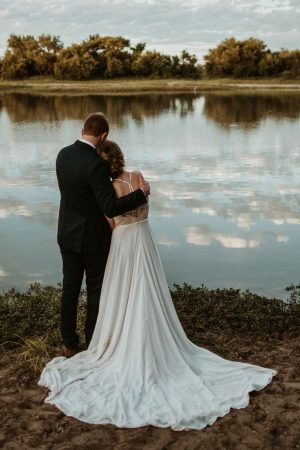 Delicate embroidered lace halter neck wedding gown with Bohemian feel